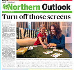 Mother and daughter play a game during screen free week